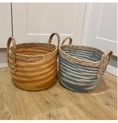 Perfect for storage solutions or decorative features in the home, an assorted sized set of woven baskets with a burnt o