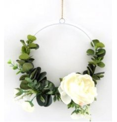 A beautifully simple half decorated wreath set with eucalyptus leaves and a floral feature