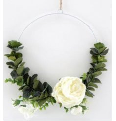 a half decorated ring wreath set with climbing eucalyptus and a floral touch