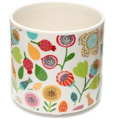 A beautifully decorated 3 legged ceramic planter from the Pick of the Bunch range