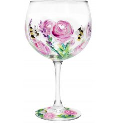 A beautifully decorated Balloon Gin Glass set with assorted pink hues, busy bees and an abstract finish
