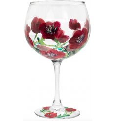 A beautifully decorated Balloon Gin Glass set with deep red hues, green flecks and an abstract finish