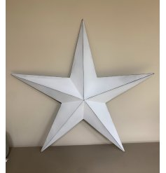 An Extra Large sized metal Barn Star set with a rustic white base tone and black lining