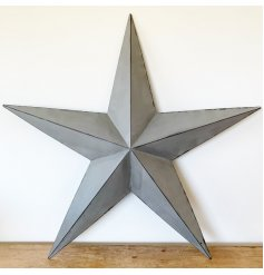 An Extra Large sized metal Barn Star set with a grey base tone and black lining