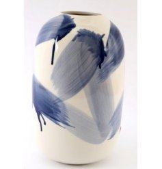 a sleek and smoothly finished dolomite vase with a blue brush stroke patter