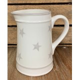 A charmingly simple ceramic jug featuring a grey ridge decal and added faded star print