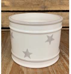 a simple ceramic pot with grey ridged edges and a faded star print