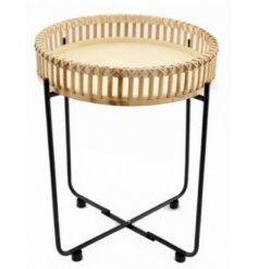 A round woven bamboo top with metal legged side table set