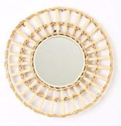 A small circular rattan woven mirror, perfect for adding to any home wanting a Boho feel to the space