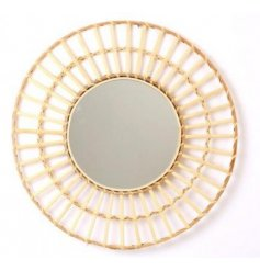 A large circular rattan woven mirror, perfect for adding to any home wanting a Boho feel to the space