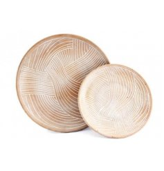 an assorted sized set of wood based plates with wave line embossments