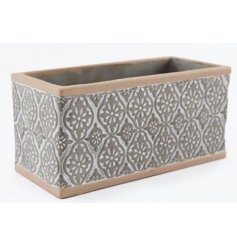 Set with its grey and cream two tone and embossed print, this rectangular planter is perfect for bringing to any space i