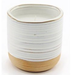 With its natural tones and charmingly simple look, this ribbed candle pot with a two tone setting will tie in with any