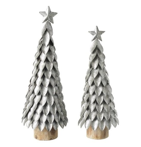 An assorted sized set of metal standing tree decorations complete with festive and glittery tones