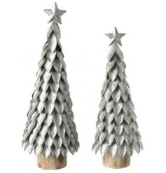 An assorted sized set of standing tree decorations set with glitzy silver tones and a charming wood block base