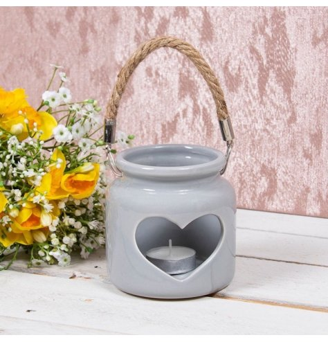 Grey toned ceramic T-light holder with heart cut . Simple and Charming, perfect for any themed space at Christmas