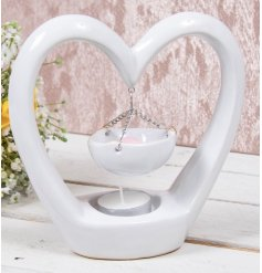 A beautifully sleek and simple heart shaped tlight holder set with a chain hung dish for oils and wax tarts melting