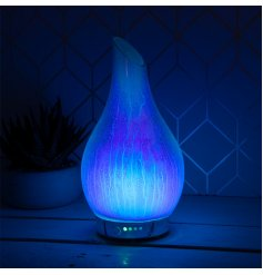 A gorgeously decorated Blue Supernova Humidifying Lamp with an added LED Aroma Bulb inside