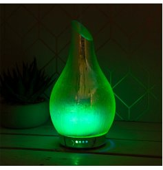 A gorgeously decorated Green Supernova Humidifying Lamp with an added LED Aroma Bulb inside