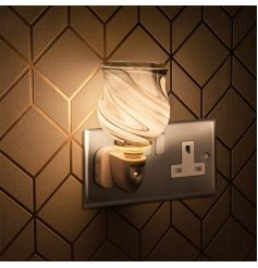 A plug in operated desire aroma light decorated with sleek grey marble decal