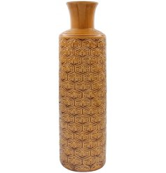A vintage style vase with a honeycomb and bee pattern, perfect for any home space