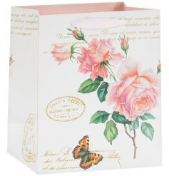 A charming little gift bag decorated with a vintage rose print and added script text decals