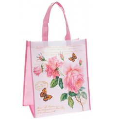 A charming little shopping bag decorated with a vintage rose print and added script text decals