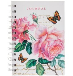 A pretty pink toned hard back notebook set with added floral decals and fluttering butterflies