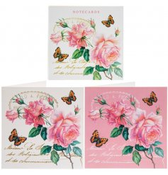 An assortment of pretty pink and delicate white toned notecards with a delightful rose decal to each