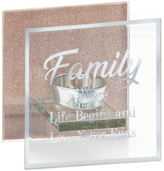 A beautiful clear glass tlight holder featuring a scripted Family text decal and a glittery rose gold backing