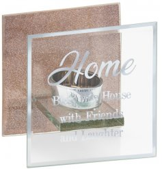 Sure to bring a luxury hint to any home space, a clear glass tlight holder set with a silver script text and charming gl