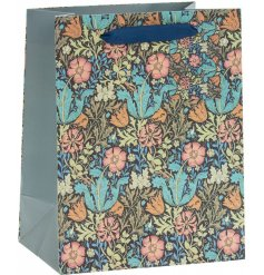 A charming little gift bag featuring a beautiful deep toned floral print and navy toned handle