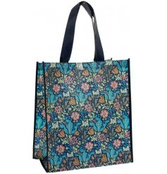 A charming little shopping featuring a beautiful deep toned floral print and navy toned handle