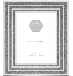 a large glass picture frame with a striking silver glitter boarder