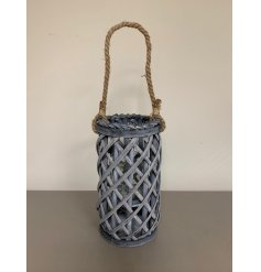 Perfect for adding a Rustic Charm to your living space, a tall standing wooden lantern with a lattice pattern and chunk