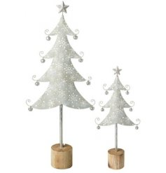An assorted sized set of metal Christmas trees set upon wooden block bases