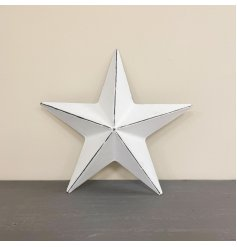 A chic and simple metal barn star featuring a rustic white painted finish