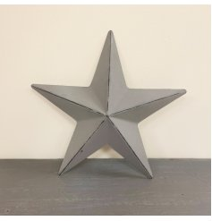 A chic and simple metal barn star featuring a rustic grey painted finish