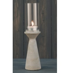 A sleek and simple themed concrete based candle holder, complete with a smooth finish and glass surround