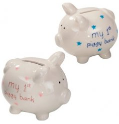 An assortment of sleek ceramic piggy banks, both set with a 'My 1st Piggy Bank' in a pink or blue script text