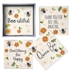 A charming set of Busy Bee printed coasters complete with a wooden holder