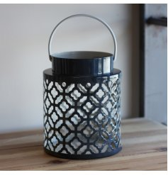 Sure to bring a modern and trendy touch to your home decor, a navy and white toned lantern with a Gatsby inspired cut d