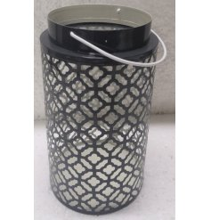 Sure to bring a modern and trendy touch to your home decor, a black and white toned lantern with a Gatsby inspired cut