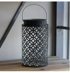 A large metal lantern featuring a Navy Grey Tone and cut out Gatsby inspired decal