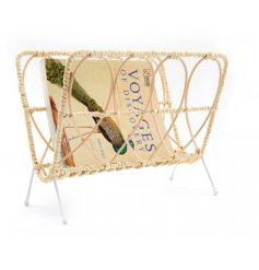 a metal magazine rack with a woven rattan finish