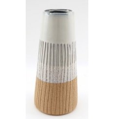 Set with natural inspired colour tones and a ribbed embossment, this tall decorative vase is a must have for any Simpli