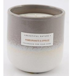 A gorgeously toned ombre candle pot  filled with a lusciously scented Pomegranate and Spruce wax