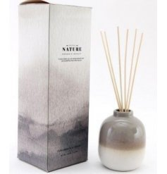 A gorgeously themed reed diffuser filled with a lusciously scented aroma liquid