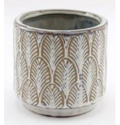 A charmingly simple themed ceramic decorative pot featuring an embossed patterned decal and rustic finish