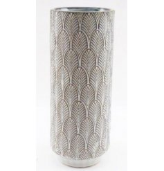 A decorative vase set with a charming embossed printed decal and simple cream tone